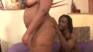 Big booty ebony BBW licking black cock