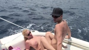 Big tits blonde jizzed on the boat